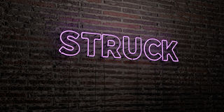 STRUCK -Realistic Neon Sign on Brick Wall background - 3D rendered royalty free stock image. Can be used for online banner ads and direct mailers Royalty Free Stock Image