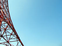 Structural background. Red steel structure on the left, against a clear blue sky. The object of the picture is Tokyo Tower Stock Photo