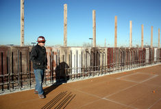 Structural concrete supervisor surveys deck; Royalty Free Stock Photo