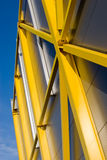 Structural details. Yellow structural details of the modern industrial building Stock Images