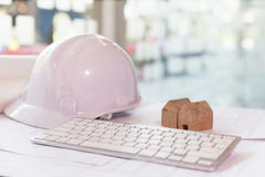 Structural engineer and architect desk with safety helmet, bluep Stock Photo