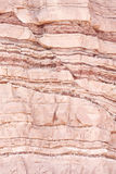 Structural geology fault. Closeup of geological layers in extensional (normal) faulted sandstone sedimentary rock Royalty Free Stock Photo