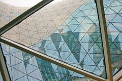 Structural glass facade curving roof of fantastic office building stock photos
