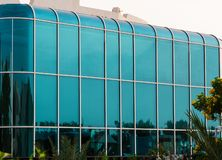 Structural glazing facade with rounded corners of typical modern building. Structural glazing facade of typical modern building. Minimalist architectural design stock images