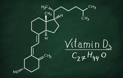 Structural model of Vitamin D3 molecule. On the blackboard Royalty Free Stock Images