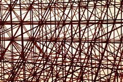 Structural orange steel cross construction abstract background Royalty Free Stock Image