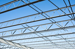 Structural steel construction. The structural steel structure of a new commercial building against a clear blue sky in the background Stock Photo