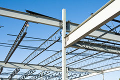 Structural steel construction. The structural steel structure of a new commercial building against a clear blue sky in the background Royalty Free Stock Photography