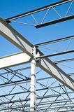 Structural steel construction. The structural steel structure of a new commercial building against a clear blue sky in the background Stock Images