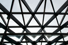 Structural steel cross construction and glass roof Stock Photography