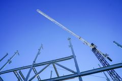 Structural steel framework for new building. White structural steel framework for new building against deep blue sky royalty free stock images