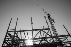 Structural steel framework for new building. White structural steel framework for new building against deep sky in monochrome stock photos