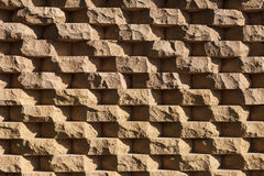 Structural wall made of rough natural stone. Stock Photos