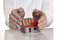 Hands protecting a house Stock Photography