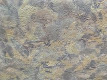 Structure of abstract background in the form of a rough patchy plaster of gray brown color. Texture of colorful decorative wallpaper, closeup Royalty Free Stock Photo