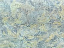Structure of abstract background in the form of a rough patchy plaster of light blue color. Texture of colorful decorative wallpaper, closeup Stock Photos