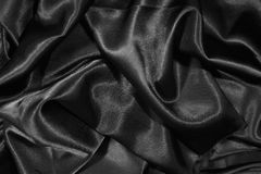 Structure of a black satin Royalty Free Stock Images