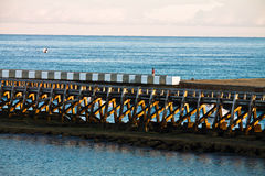 Structure of breakwater in sunrise on atlantic ocean Royalty Free Stock Images