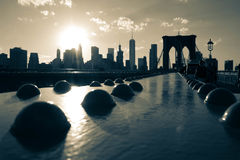 The structure of Brooklyn bridge and buildings with sunset in vintage style Stock Photography