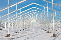 Steel construction on the background of the winter landscape. The structure of the building. Steel construction on the background of the winter landscape royalty free stock photos