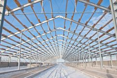 Steel construction on the background of the winter landscape. The structure of the building. Steel construction on the background of the winter landscape stock photo