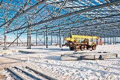 Steel construction on the background of the winter landscape. The structure of the building. Steel construction on the background of the winter landscape stock images