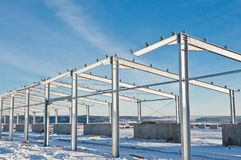 Steel construction on the background of the winter landscape. royalty free stock photography
