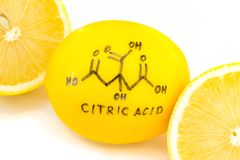 Structure of a citric acid molecule painted on lemon peel. Abstract background Royalty Free Stock Images