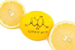 Structure of a citric acid molecule painted on lemon peel. Abstract background Stock Photo