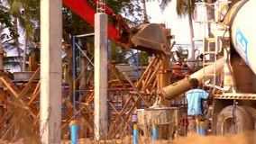 Structure of concrete mixing in construction site stock video