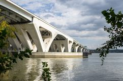 Structure of a Concrete Road Bridge over a River. Modern Concrete Highway Bridge across a River under Cloudy Sky on an Autumn Day. Alexandria, VA, USA Royalty Free Stock Photography