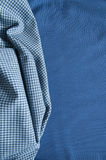 Structure of cotton fabric on a blue fabric background Royalty Free Stock Photos