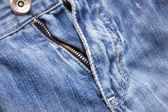 Structure of a dark blue jeans fabric Royalty Free Stock Images