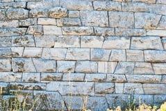 Structure du grec ancien sur le mur de marbre situé sur l'île de Delos images libres de droits