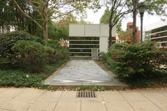 Structure With Foliage, Grating and Drain. On a university campus Stock Image