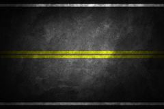 Structure of granular asphalt. Asphalt texture with two yellow line road marking. royalty free stock photos