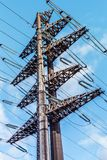 Structure of the high-voltage electrical metal supports. Against the sky Royalty Free Stock Photos