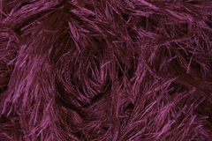 Structure of magenta fabric. Magenta coloured fabric curled of Stock Image