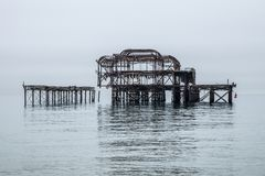 Structure of an old pier. Reflected in the sea water Royalty Free Stock Photo
