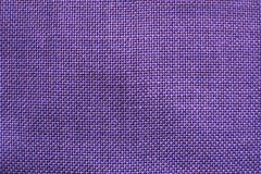 Structure of purple violet fabric. With natural texture as background Stock Images