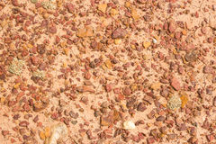 Structure of red clay with rocks Royalty Free Stock Images