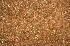 Structure of red clay with rocks Royalty Free Stock Image