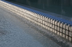 Structure in a reflecting pool. Background Royalty Free Stock Photos