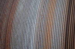 Structure: rusty steel wire on a cable drum. Details of a rusty steel wire rope on a cable drum aboard a fishery vessel Stock Photo