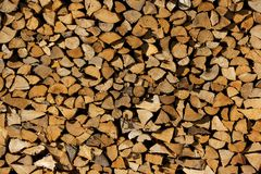 Structure of stacked wood chunks. Pile of wood stored for winter heating Royalty Free Stock Photo
