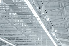 Structure of metal industrial roof with skylights and exhibition. Structure steel frame of metal industrial roof with skylights and exhibition lighting rig royalty free stock image