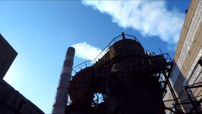 The structure of the steel plant on the background of the pipe stock footage