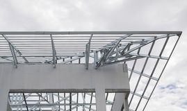 Structure of steel roof frame with blue sky and clouds Royalty Free Stock Photo