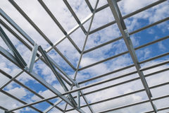 Structure of steel roof frame at construction site Stock Image