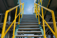 Structure steel of staircase in oil refinery plant. Royalty Free Stock Images